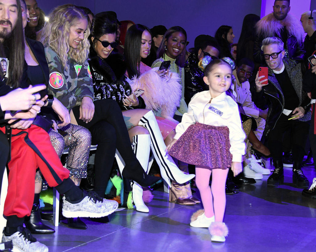 Four-year-old child captures everyone's attention at Jeremy Scott runway show during NYFW.