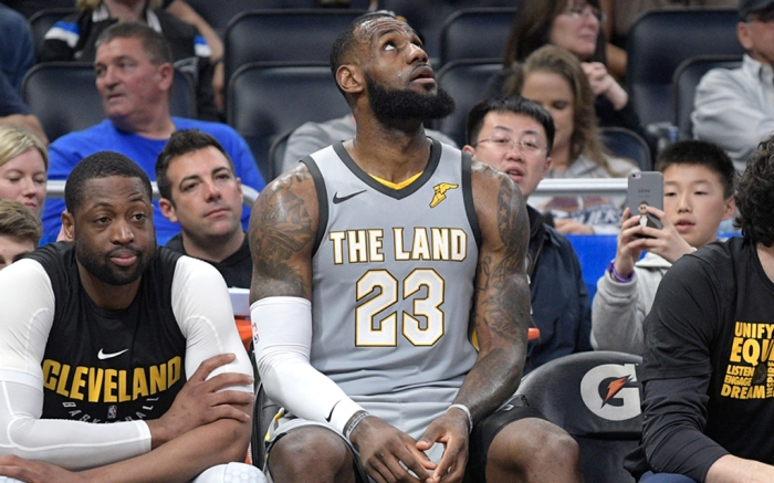 Cleveland Cavaliers forward LeBron James (23) and guard Dwyane Wade, second from left, watch from the bench during the second half of an NBA basketball game against the Orlando Magic Tuesday, Feb. 6, 2018, in Orlando, Fla. The Magic won 116-98. (AP Photo/Phelan M. Ebenhack)