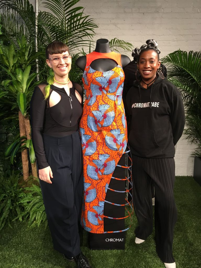 Becca McCharen-Tran, left, the founder of Chromat, stands with Chromat designer Tolu Aremu and a dress they created for a small collection inspired by the film