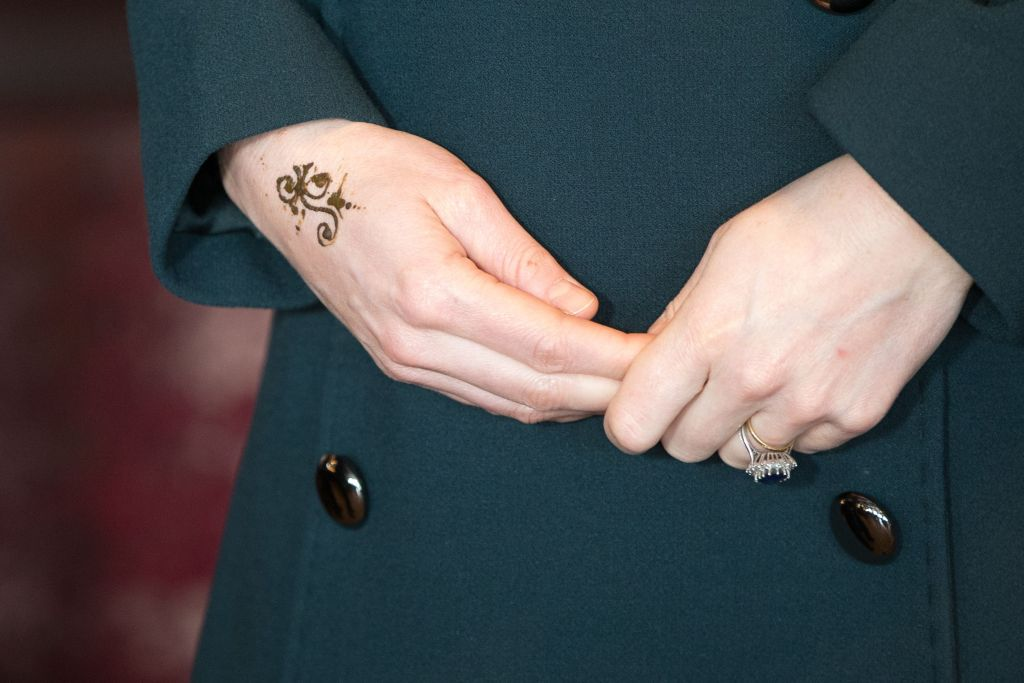 Kate Middleton gets a henna tattoo on her hand.