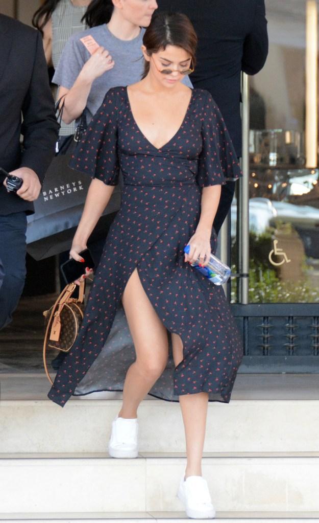 Selena Gomez, cherry dress, puma sneakers