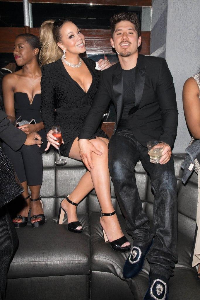 Mariah Carey and her boyfriend Bryan Tanaka are sitting together inside Floyd Mayweather birthday celebration.