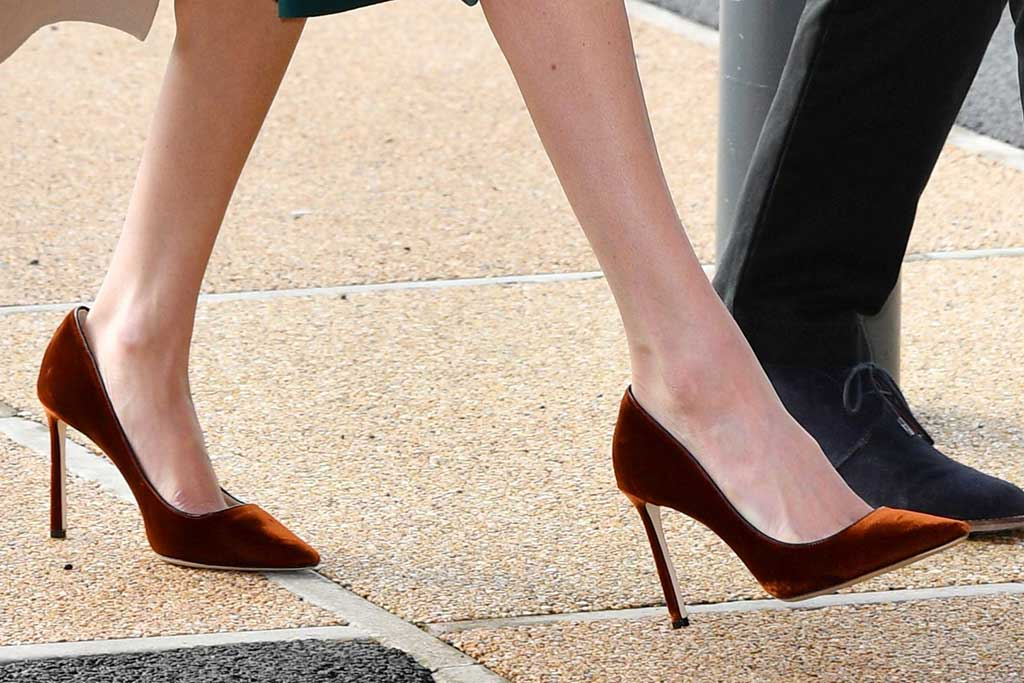 Meghan Markle wears Jimmy Choo bronze velvet pumps.