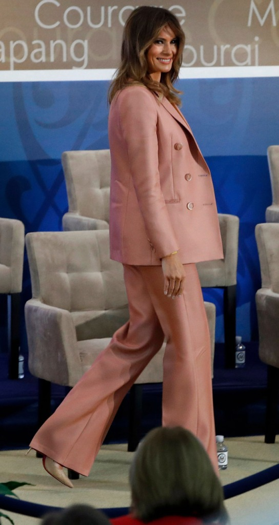 Melania Trump, emilio pucci suit, christian louboutin pumps, yellow sweater, celebrity style, march 2018