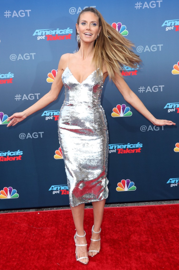 Heidi Klum twirls around on the red carpet.