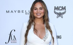 Chrissy Teigen pregnant, daily front row