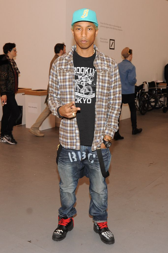 Pharrell wearing Chanel boots in 2012