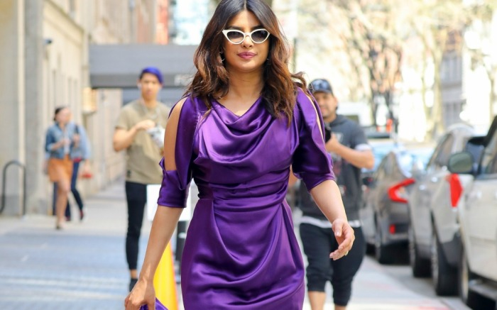 Priyanka Chopra confidently walks out into the Big Apple wearing a standout purple dress.