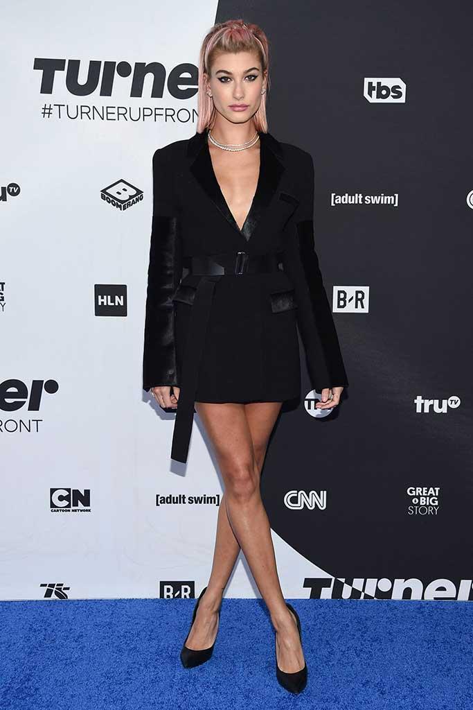 Hailey Baldwin wears David Koma blazer and Casadei pumps in New York.