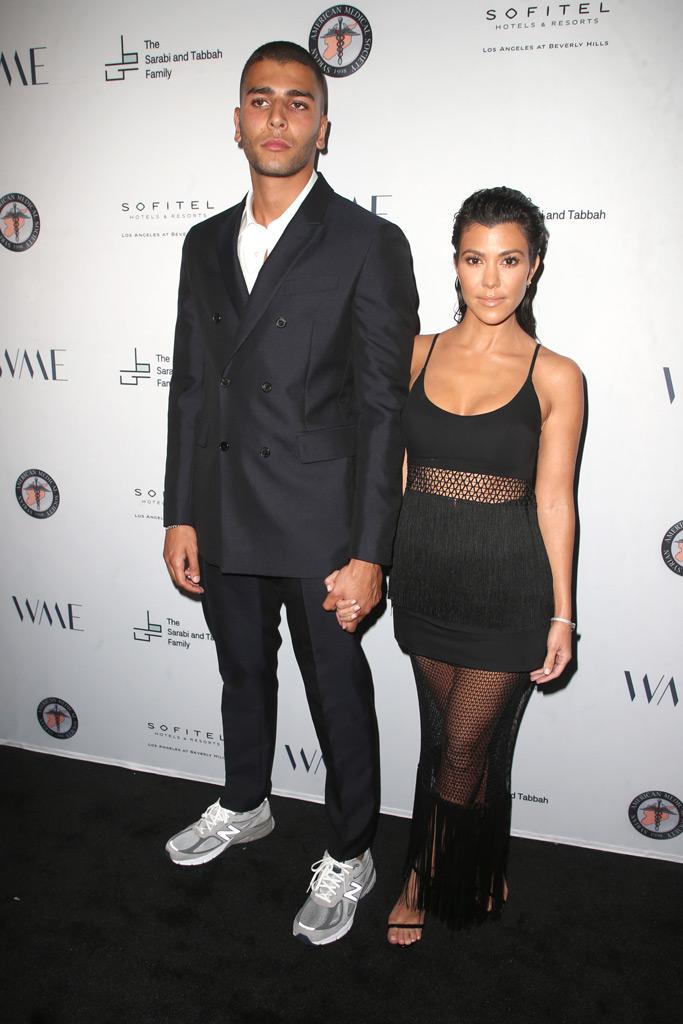 Kourtney Kardashian, boyfriend, younes bendjima, holding hands, red carpet