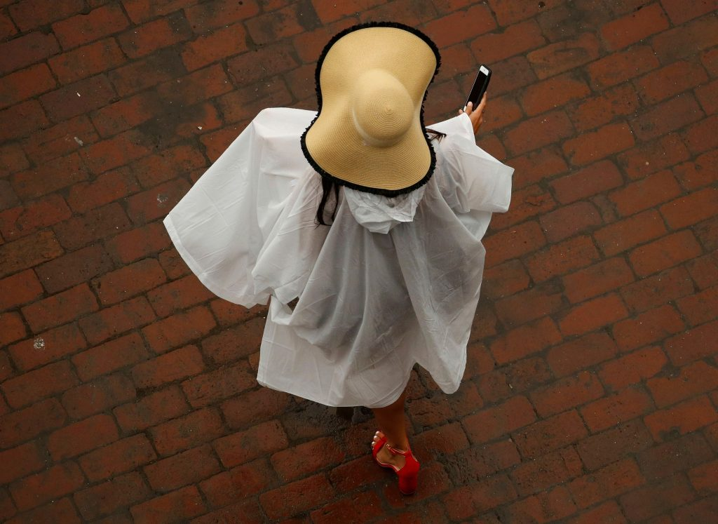 A woman wears a hat before the 144th running of the Kentucky Derby horse race at Churchill Downs, in Louisville, KyKentucky Derby Horse Racing, Louisville, USA - 05 May 2018