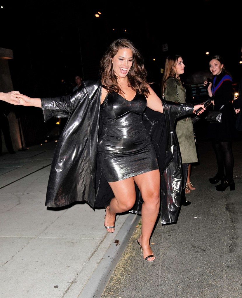 Ashley Graham navigates her way off a curb when departing Harry Josh's Met Gal pre-party.