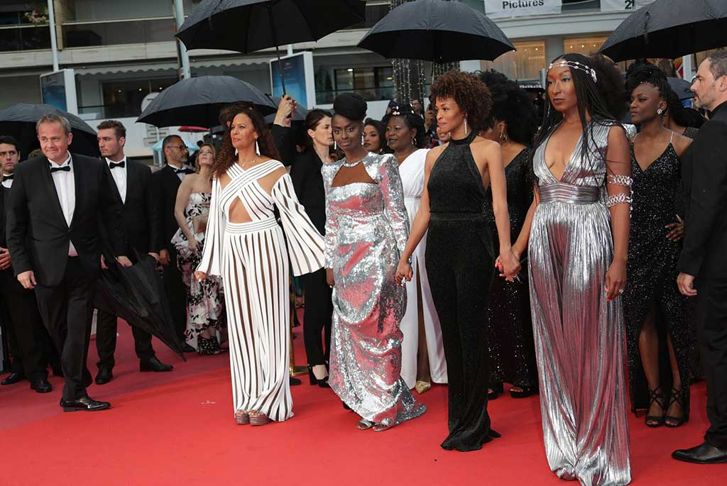 """Black Is Not My Job"" co-authors wearing Balmain for their protest on the Cannes red carpet."