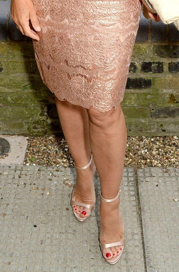 elizabeth hurley feet, rose gold sandals, dress