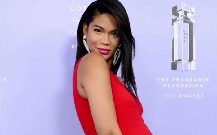 Chanel Iman sizzles in bold red dress.