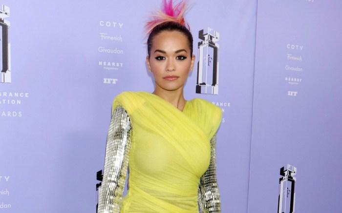Rita Ora's bright yellow and metallic look turns heads in the Big Apple.
