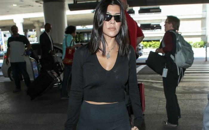 Kourtney Kardashian rocks all-black airport look.