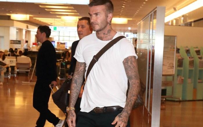 David Beckham wears plain white T-shirt to the airport.