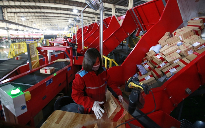 JD.com warehouse worker sorts boxes
