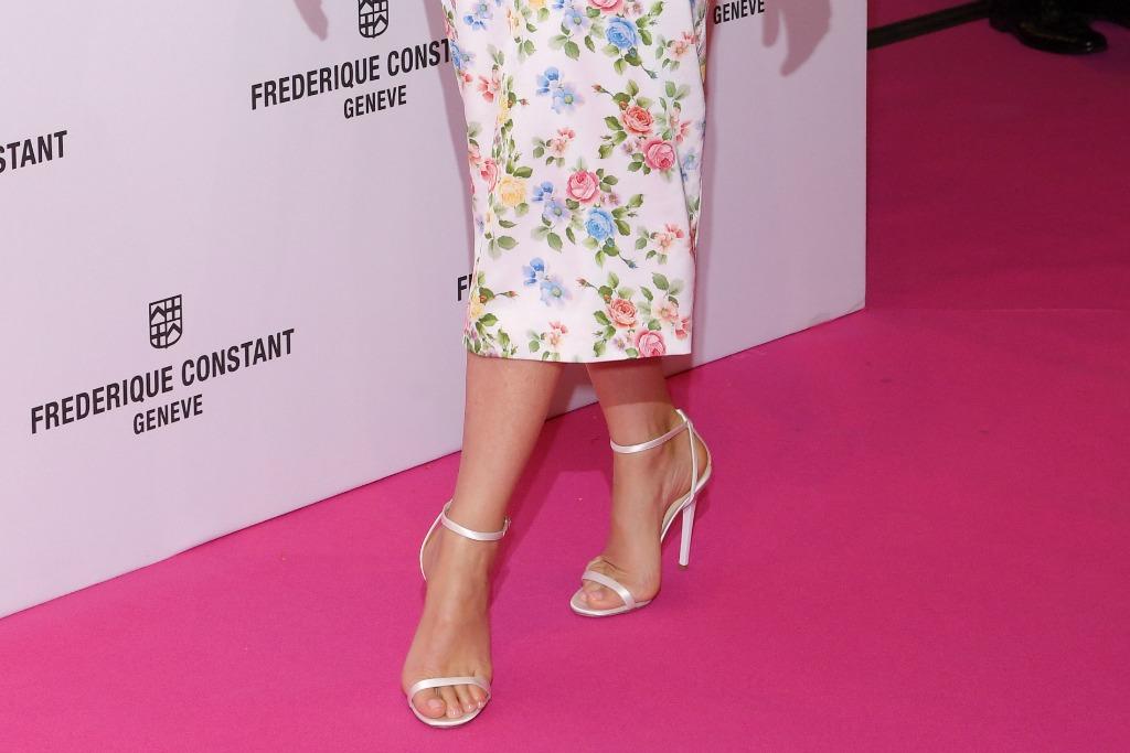 Gwyneth Paltrow wore white Jimmy Choo Minny sandals.