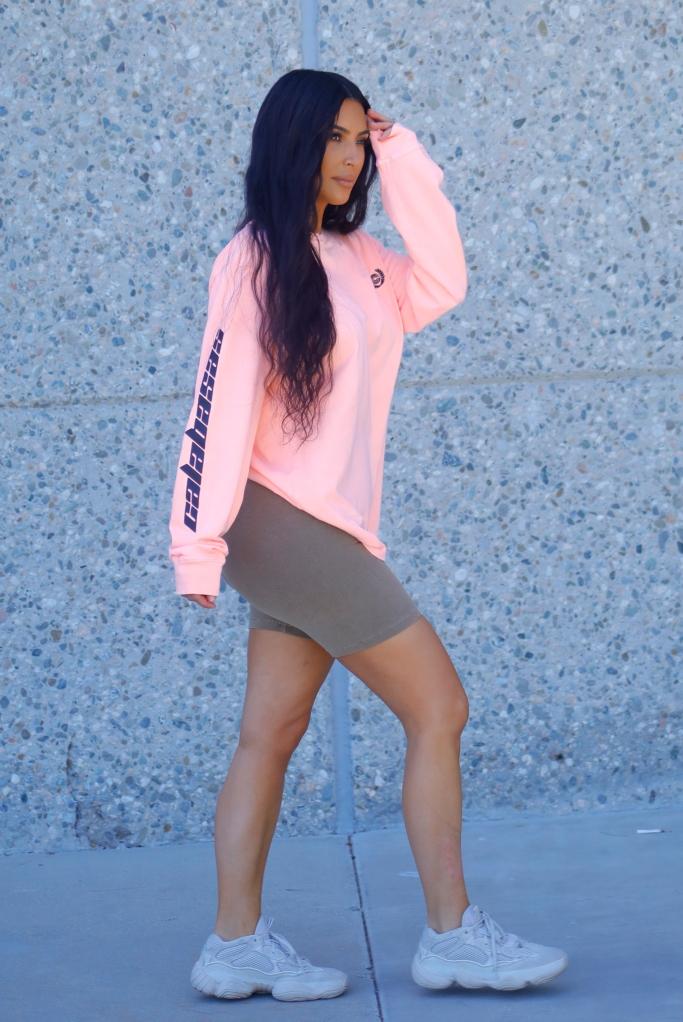 yeezy, desert rat 500 sneakers, neon pink calabasas t-shirt, yeezy bicycle shorts
