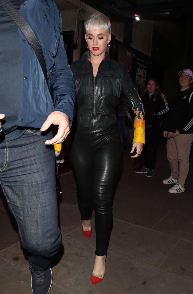 Katy Perry steps out in the U.K. wearing a black look.