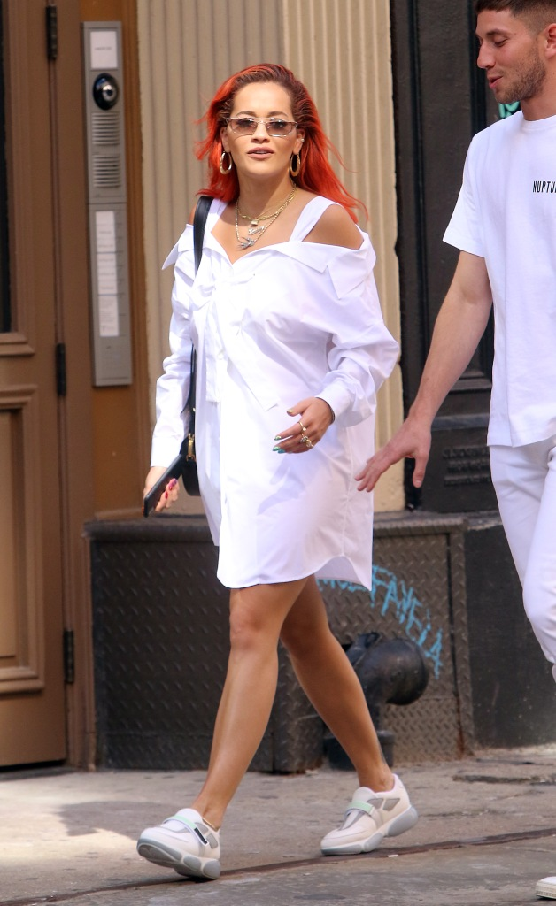 Rita Ora's recently debuted red hairstyle stands out in all-white NYC look.