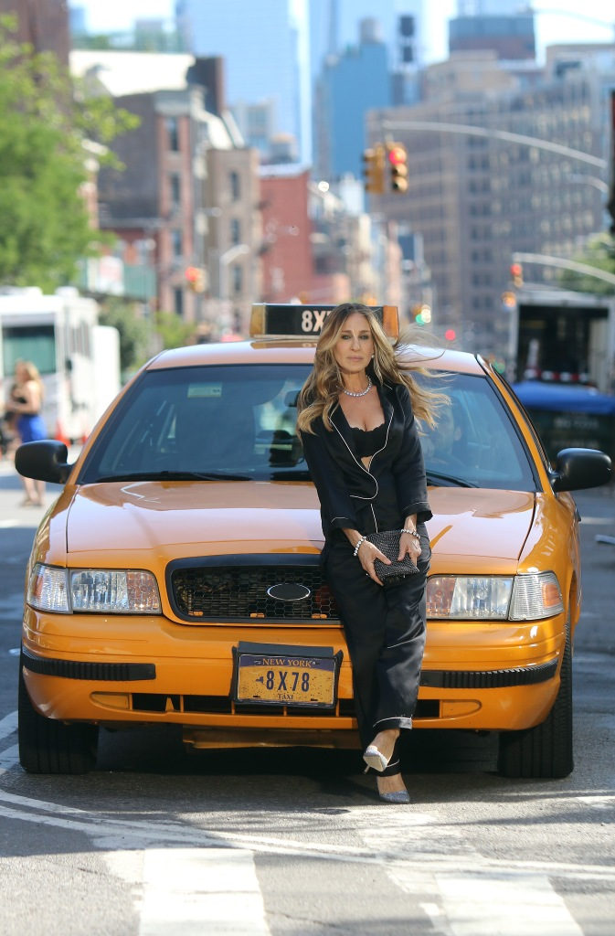 Sarah Jessica Parker poses in front of a yellow cab for her Intimissimi lingerie commercial.