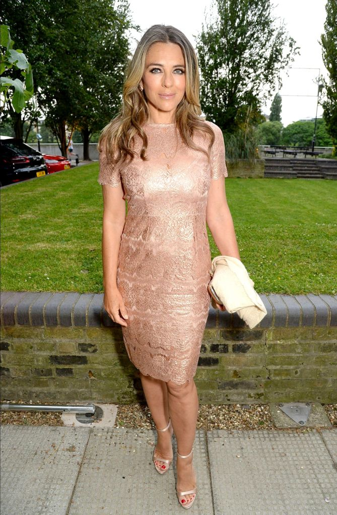 Elizabeth Hurley made it out to the NSPCC event in a glamorous rose gold number at the River Cafe in London.