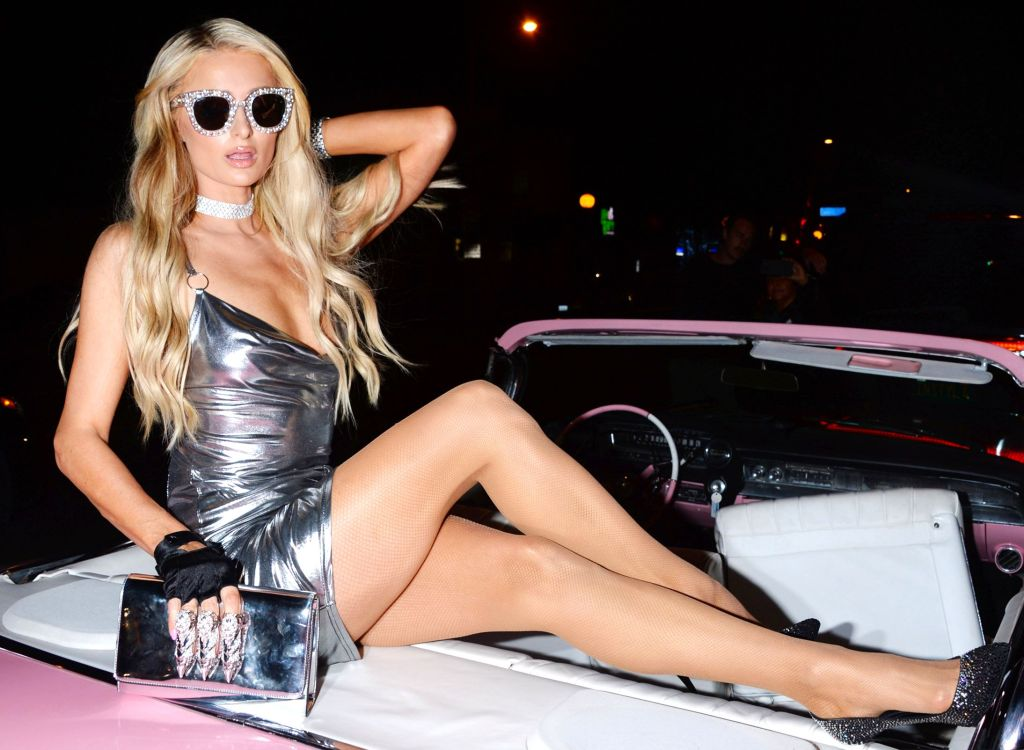 Paris Hilton struck a pose on an adorable pink convertible at her Boohoo collaboration celebration.