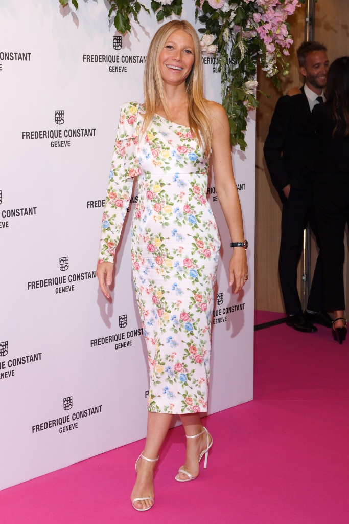Gwyneth Paltrow looks stunning in floral off-the-shoulder dress and white Jimmy Choo sandals at the Gwyneth Paltrow x Frederique Constant watch launch party in London.