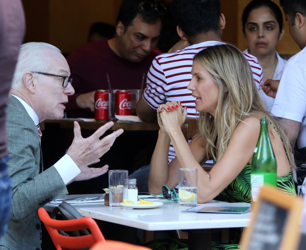 'Project Runway' duo Heidi Klum and Tim Gunn share a meal together in Manhattan.