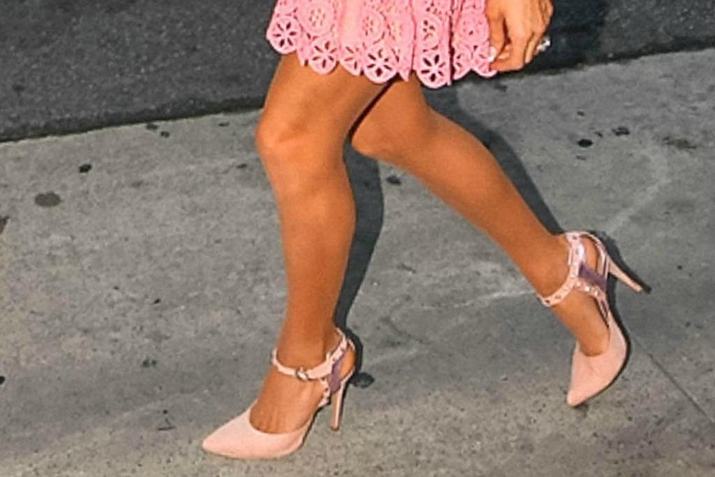 Paris Hilton walking around in blush pink pointed pumps.