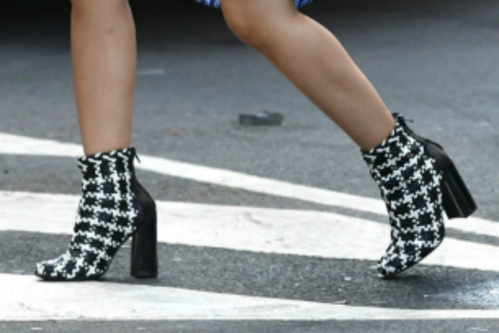 Camila Cabello's shoes black and white printed booties.