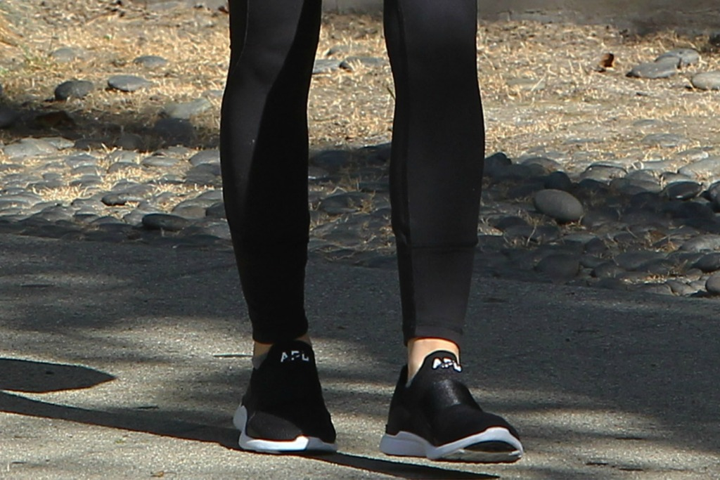 Lucy Hale's black APL sneakers.