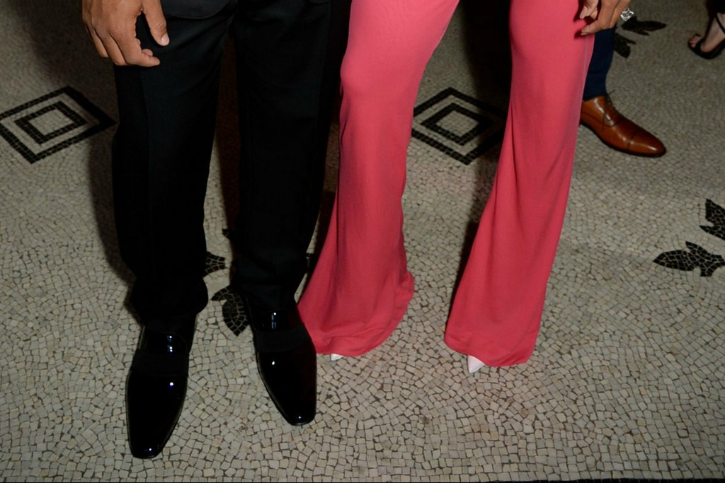 Russell Wilson's black dress shoes and Ciara's white pointed pumps.
