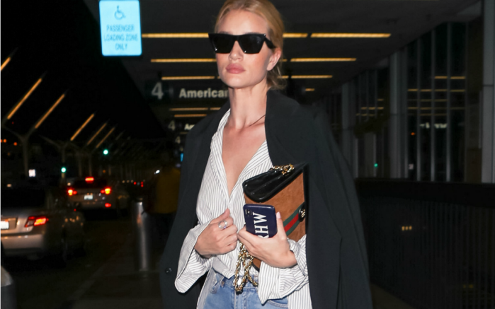 Rosie Huntington-Whiteley heads out of LAX international airport.