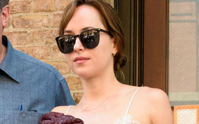 Dakota Johnson heads out of her hotel in the Big Apple.
