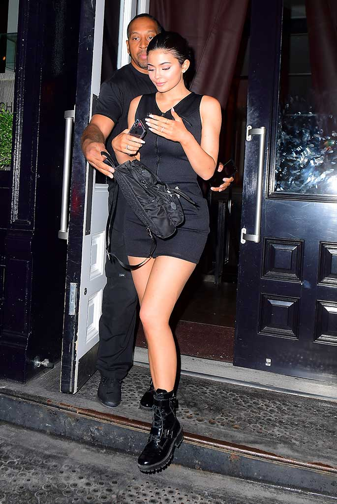 Kylie Jenner wears a Fendi dress and work boots.