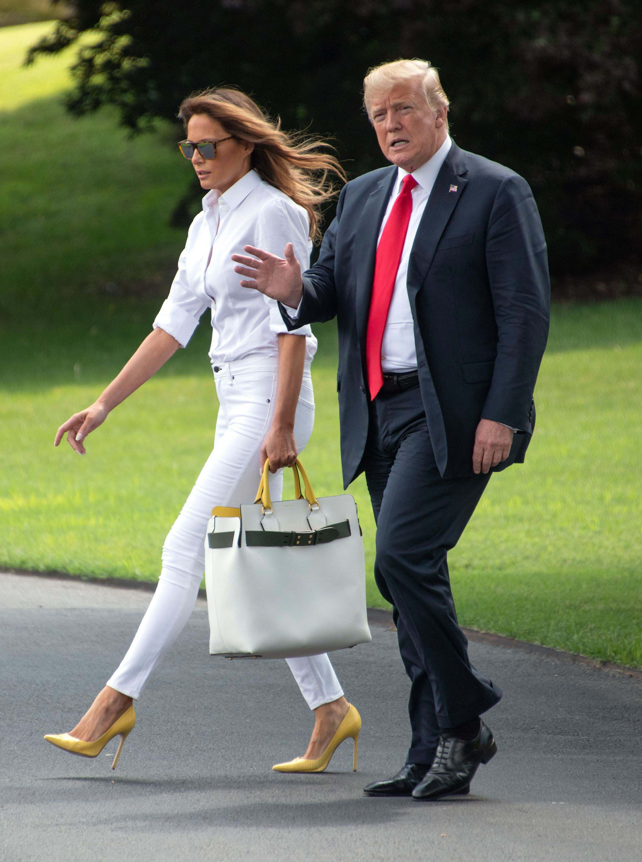 manolo blahnik bb pumps, United States President Donald J. Trump waves to the press as he and first lady Melania Trump depart the South Lawn of the White House in Washington, DC en route to Bedminster, New Jersey.Donald Trump departs the White House, Washington, DC - 27 Jul 2018