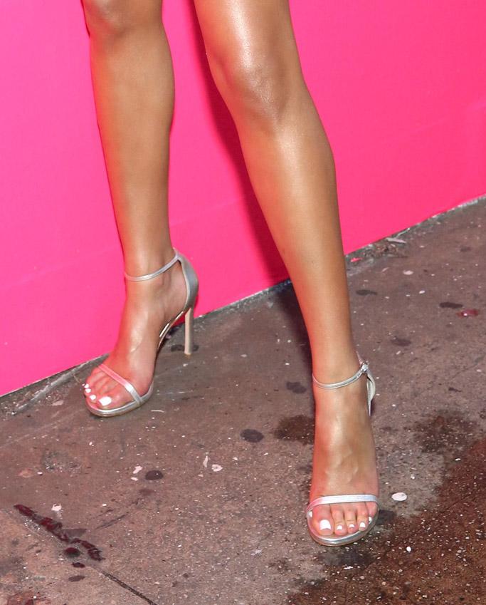 Olivia Culpo wears a wrap dress with silver sandals, beautyblender, sandals, feet