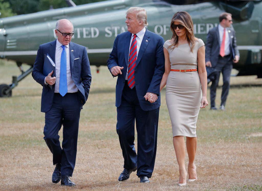 Melania Trump, Donald Trump, Woody Johnson. President Donald Trump, center, and first lady Melania Trump, right, walk with Woody Johnson, left, United States Ambassador to the United Kingdom, following their arrival on Marine One helicopter in Regent's Park, near the residence of the US Ambassador, following their arrival, LondonTrump, London, United Kingdom - 12 Jul 2018