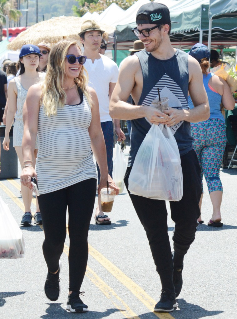 Pregnant Hilary Duff goes on a date to the farmer's market in Los Angeles with boyfriend Matthew Koma.