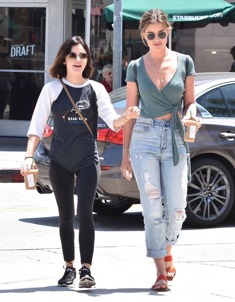 Lucy Hale steps out to get a Starbucks iced coffee in Los Angeles wearing a laid-back athleisure look.
