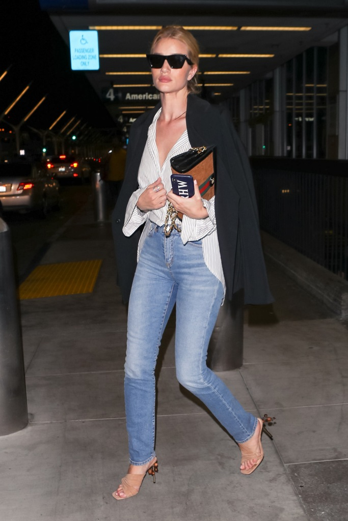 Rosie Huntington-Whiteley leaves the LAX International airport in laid-back off-duty look with nude mules.
