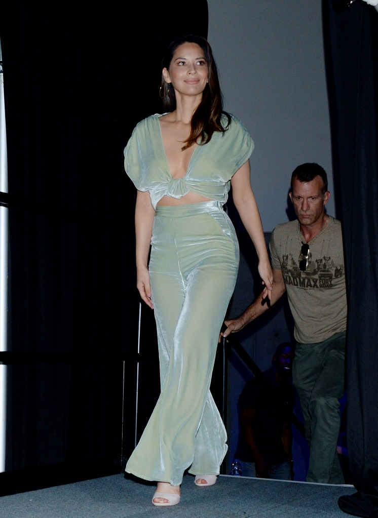 Olivia Munn makes an appearance at 'The Predator' film panel during Comic-Con International in San Diego wearing a flattering sea green jumpsuit.