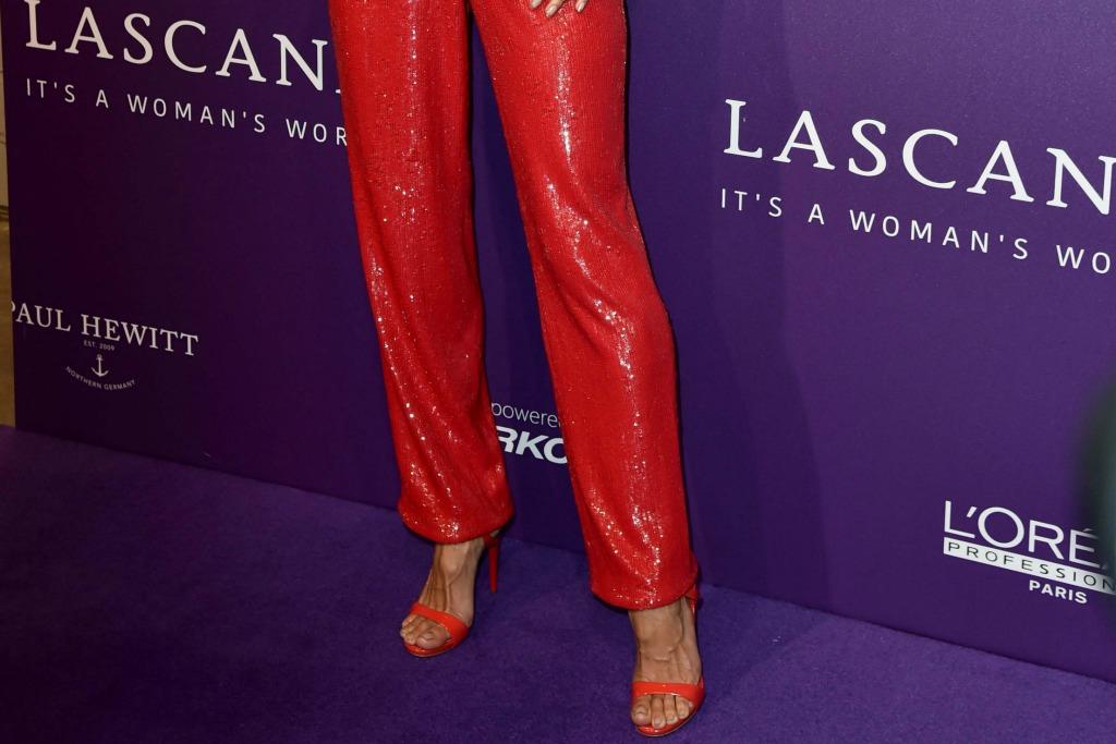 Alessandra Ambrosio wearing Giuseppe Zanotti G-Heel sandals, feet, red shoes