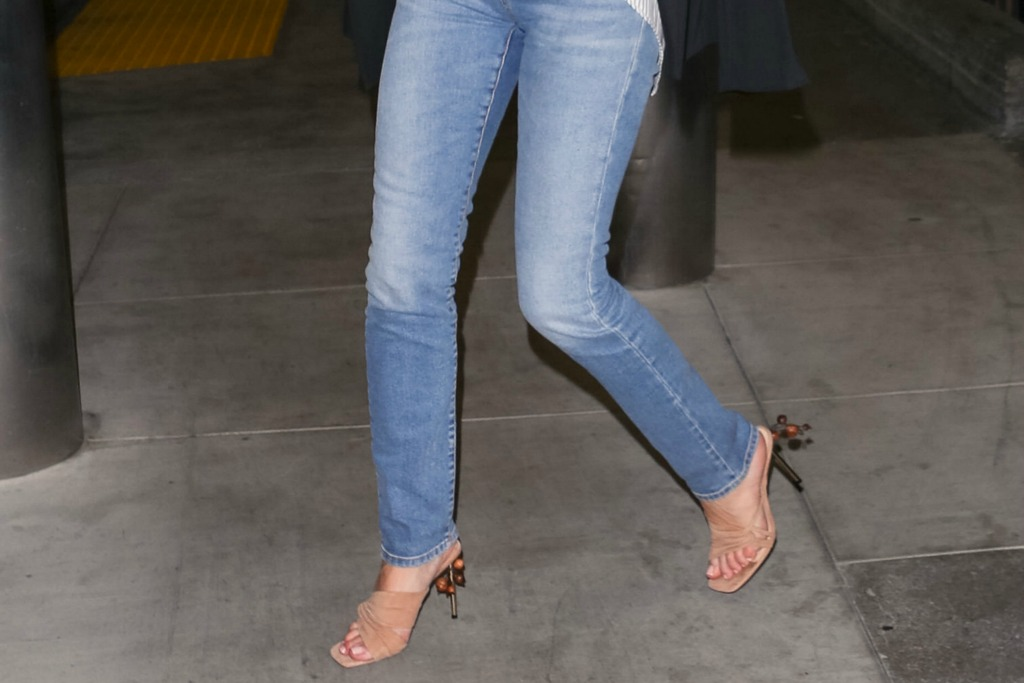 Rosie Huntington-Whiteley travels in standout nude mules.