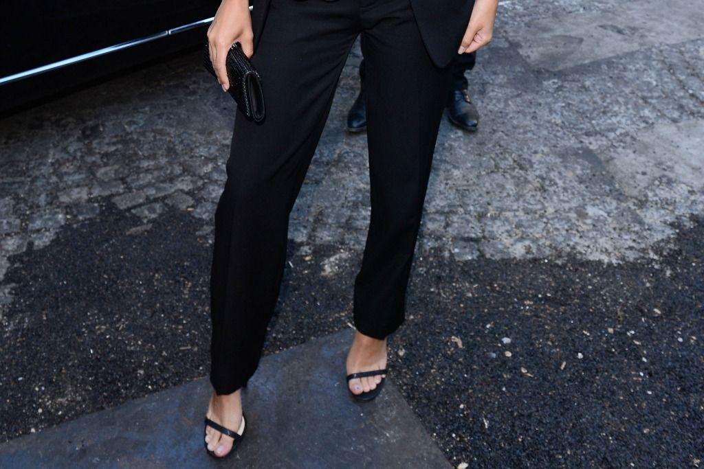 Emily Ratajkowski slipped on thin strapped black sandals in Paris.