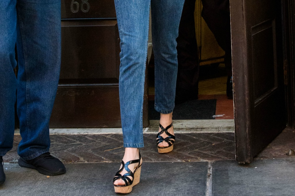 Dakota Johnson rocks black wedge platform sandals.